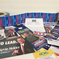 We print a diverse array of affordable political products: campaign signs, push cards, political postcards, lapel stickers, bumper stickers, political door hangers, flyers, posters, business cards, and more.