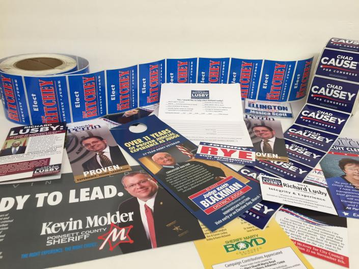 [Image: We print a diverse array of affordable political products: campaign signs, push cards, political postcards, lapel stickers, bumper stickers, political door hangers, flyers, posters, business cards, and more.]