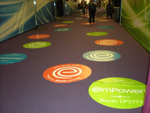 [Image: Add interest to your next event or store display with custom floor decals. ]