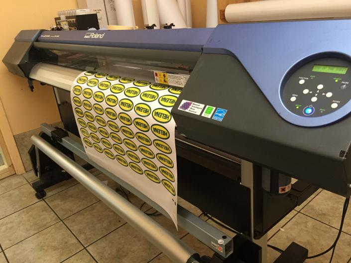 [Image: Our wide format printer offers us the ability to create various products: posters, decals on various materials, banners, magnets and more!  ]